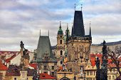 stock photo of bridge  - View of the Lesser Bridge Tower of Charles Bridge in Prague Czech Republic - JPG