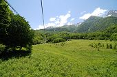 foto of olympic mountains  - Mountains near Sochi before the Olympic games objects building - JPG