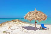 picture of caribbean  - Grass umbrella at the beach on Aruba in the Caribbean - JPG