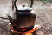 picture of boiling water  - old kettle for boiling water on charcoal stove - JPG