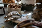 picture of knife  - knife and cake knife on buffet table and different sweets - JPG