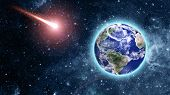 image of comet  - comet coming to blue planet in space Elements of this image furnished by NASA - JPG