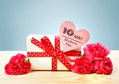 image of carnations  - Mothers Day May 10th message with present and pink carnation flowers - JPG