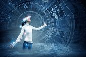 picture of hologram  - Young pretty asian woman touching digital hologram - JPG