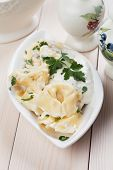 picture of italian parsley  - Italian tortellini pasta with cheese sauce and parsley - JPG