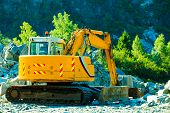 picture of excavator  - Industry yellow heavy duty excavator machine digger on construction site outdoor - JPG