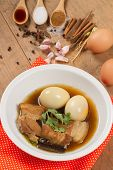 """pic of pork  - """"eggs and pork stewed in the gravy"""" or """" eggs and pork in brown sauce"""" are the traditional thai food style. - JPG"""