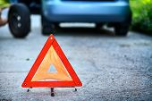 picture of backround  - Emergency stop sign in backround with broken down car  - JPG