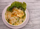 foto of glass noodles  - Glass noodle soup with chicken and beansprouts on a wood table top background - JPG