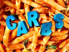 foto of carbohydrate  - Carbs carbohydrates nutrition concept as a plate of cooked pasta with the word for complex sugar imbedded in the starch rich food as a diet and dieting lifestyle concept for healthy portion control - JPG