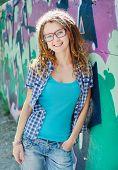 foto of dreadlock  - Stylish slim girl with dreadlocks - JPG