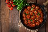 foto of meatball  - Meatballs in sweet and sour tomato sauce on table - JPG