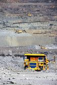 stock photo of mines  - Heavy mining truck on the iron ore opencast mining quarry - JPG