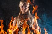 picture of woman dragon  - beautiful woman with a dragon egg in hands isolated on black background - JPG