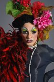 pic of transexual  - Drag Queen Daruma in studio with flowers on top of the head - JPG