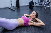 pic of crunch  - Muscular woman doing abdominal crunch at the crossfit gym - JPG