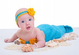 stock photo of undine  - Baby girl dressed as a mermaid  - JPG