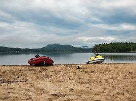 stock photo of recreational vehicle  - Recreational water vehicles on Moffitt Beach in the Adirondack State Park - JPG