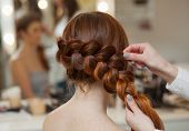 Beautiful, With Long, Red-haired Hairy Girl, Hairdresser Weaves A French Braid, Close-up In A Beauty poster