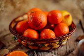 Постер, плакат: Basket Of Tangerines On A Wooden Table Delicious And Beautiful