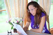 beautiful young girl reading menu in coffee-house