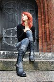 pic of red hair  - girl with red hair is sitting on the stairs - JPG