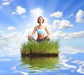 joung girl meditating on island