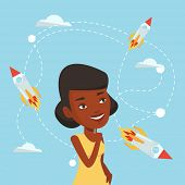 An african-american woman looking at flying business rockets. Young woman came up with an idea for a poster