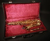golden saxophone in black case
