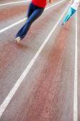 Image of race track with blurred feet on it