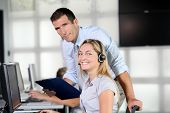 Blond woman with headphones in training course