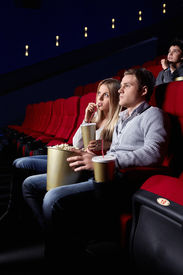pic of movie theater  - A young couple in a movie theater - JPG