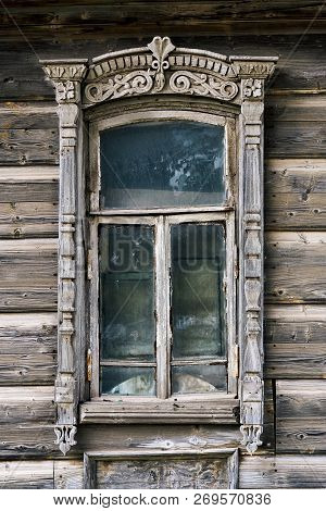Old Shabby Carved Window Of