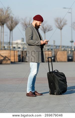 poster of Let Travel Begin. Traveler With Suitcase Waiting Transportation To Airport Railway Station. Ready To