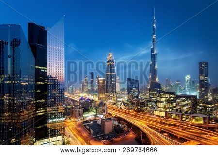 poster of Beautiful Aerial View To Dubai Downtown City Center Lights Skyline At Night, United Arab Emirates. L