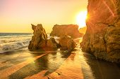 El Matador State Beach, California, United States. Sunbeams With Sunset Lights Between Pillars And R poster