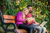Couple With Book And Laptop Search Information. Use Digital Approach As Well As Books. Man And Woman poster