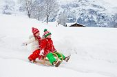 Kids Play In Snow. Winter Sleigh Ride For Children poster