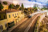 Model Of Small Railway Station With Train Approaching poster