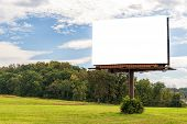 Horizontal Shot Of A Giant Blank Billboard Mounted On A Pole In An Autumn Setting With Copy Space. poster