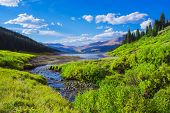 Gorgeous Mountain Landscape Valley Lake And Stream With Lush Bush And Pine Forest poster