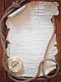 old paper and cooper compass with cord