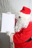 Santa Claus. Santa Claus with his Naughty or Nice List of Good or Bad Children. Good boys and girls. poster