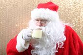 Santa Claus Enjoys his glass of Eggnog. Santa Claus drinks Eggnog for Christmas. Eggnog Drink. Holid poster