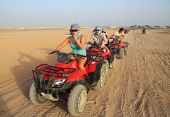 SINAI MOUNTAINS DESERT NEAR SHARM EL SHEIKH, EGYPT - MARCH 9: Unidentified people on quad trip in Egypt - one of the local travel attraction March 9, 2010 in Egypt