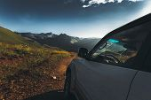 Concept Offroad Trip. Car On Mountains And Clouds Background. Road Adventure Vacation Concept poster