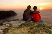 Loving Couple at sunset on irish Cliffs of Moher