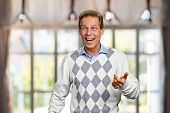Portrait Of Happy Surprised Man. Adult Casual Man In Sweater Looking Shocked On Blurred Background.  poster