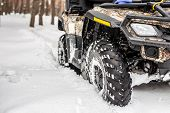 Close-up Atv 4wd Quad Bike In Forest At Winter. 4wd All-terreain Vehicle Stand In Heavy Snow With De poster