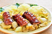 Sausage with white cabbage